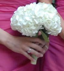 white hydrangea bridesmaid bouquet, tie with purple ribbon