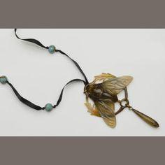An Art Nouveau carved horn pendant (by Bonté ?)