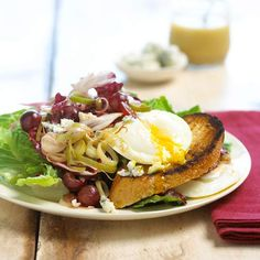 Warm leeks and grapes are tossed with tangy blue cheese and mixed greens. Toast topped with a creamy poached egg keeps the meal hearty.