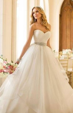 I love the sweetheart neckline...not sure about the bottom but if I decide to go princessy it is beautiful