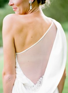 Sheer back one shoulder wedding dress: http://www.stylemepretty.com/2016/02/19/10-dresses-all-about-business-in-the-front-party-in-the-back/