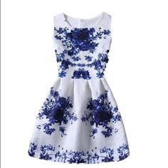 Epic DealBlue Floral Dress size Large❤️ New with tags, blue floral print dress size large. Runs small, back zipper. Jacquard/cotton blend, sleeveless with flare. Length: 31.5 inches, waist 30 inches, shoulder: 12.8 inches, bust: 35 inches. Gorgeous! Zay Dresses