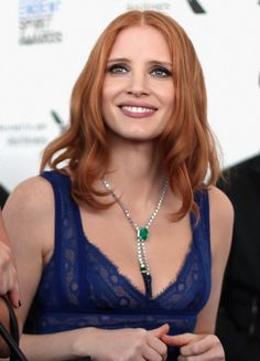 Jessica Chastain in an 18k white gold necklace set with sapphire beads, emeralds and diamonds.