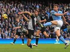 Edin Dzeko's late winner gave Manchester City a dramatic victory over Tottenham that keeps them in touch with leaders Manchester United and just two points off the top of the Premier League. Manchester City, Manchester United, Bay Sports, Team 2, Man United, Critic, Football Soccer, Sports News, Premier League
