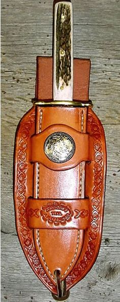 I love this holster/sheath. Well tooled and decorative. Axe Sheath, Knife Sheath, Leather Tooling Patterns, Leather Pattern, Cowboy Holsters, Knife Holster, Leather Workshop, Best Pocket Knife, Leather Holster
