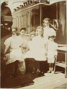 "Empress Alexandra Feodorovna of Russia with her children on the Standart. ""AL"""