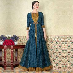 Fancy Blue And Khakhi Color Tussar Silk Print Printed Party Wear Jacket Style Anarkali Suit Add glamour to your ethnicity by adding this blue and khakhi color beautiful salwar kameez which gives you traditional breathe taking looks and catches the attent Abaya Fashion, Indian Fashion, Fashion Dresses, Eid Dresses, Women's Fashion, Fashion Women, Fashion Ideas, Fashion Trends, Salwar Kameez