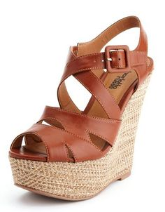 Wedges--in a fall color scheme--perfect for accentuating long legs when paired with the black shimmer skinny jeans!