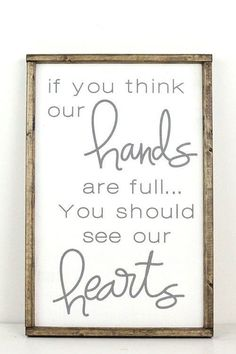 """Aww! Such a sweet message on this sign: """"If you think our hands are full... you should see our hearts"""" 