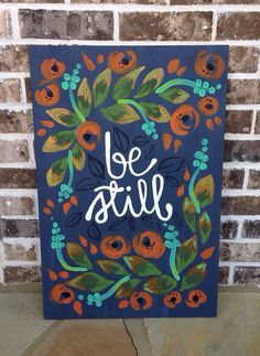 Hand-lettered Be Still and floral design in acrylic on wood. Custom colors available upon request! Size options: 16x24