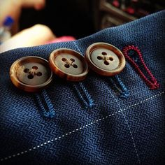 working button holes with multi-colored thread, nice touch
