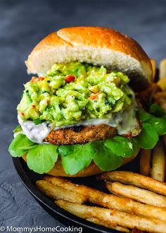 This Mango Guacamole Turkey Burger is a juicy goodnessparty for your taste buds! It's tasty, smoky, and slathered in THE BEST mango guacamole ever. The perfect, delicious and healthier time-saving alternative to your barbecue spread. AD #JennieO #MakeTheSwitch  @Jennieorecipes https://mommyshomecooking.com