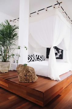 A bright bedroom with a canopy bed