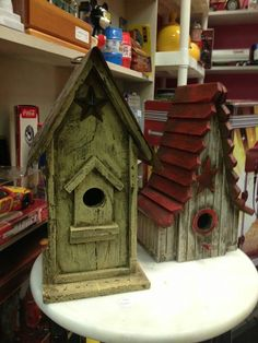 Birdhouses-rustic looking. <3 the star over the opening!