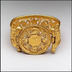 Gold bracelet It is decorated with grapevine pattern. It is 5.7cm by 3.7cm by 5.9cm  Byzantine period, 6th and 7th centrury BC (probably made in Constantinople). Source: Metropolitan Museum