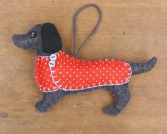 Handmade felt Dachsund ornament. Otto is a felt Dachshund Christmas ornament, handmade from dark grey felt, with a jolly buttoned jacket in printed cotton, and a cotton loop for hanging.  He measures 5 x 3.25 inches (15 x 8.5cm) You can see Ottos friends Mitzi, Emil, Bruno and Clara, and all my other felt dogs here;  https://www.etsy.com/shop/PuffinPatchwork?section_id=17300721&ref=shopsection_leftnav_4