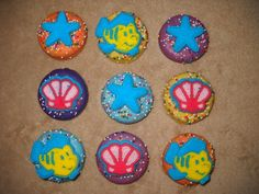 1 chocolate ariel the little mermaid edible icing oreo lollipops   sapphirechocolates - Edibles on ArtFire chocolate lollipops. castlerockchocolates at yahoo.com 307/899-7100 text any hour www.sapphirechocolates.artfire.com and stores.ebay.com/Castle-Rock-Chocolatier. made to ship 3 weeks after payment - please provide the following for a price quote especially if your event falls under the 3 week estimated arrival dates * event date * character * quantity * state * zip code * email address