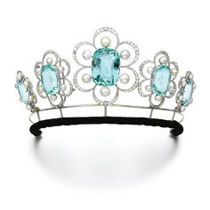 Five aquamarine, natural pearl and diamond brooches by Georges Fouquet, 1908, with a later tiara fitting.Marie Poutine's Jewels & Royals: Gem Set and Diamond Tiaras