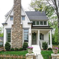 White house with Stone chimney in front. Southern Cottage Homes, Cottage Style Homes, Cottage House Exteriors, Cottage Home Plans, Stone Cottage Homes, Small Cottage Homes, Bungalow Homes, Farmhouse Homes, Stone Chimney