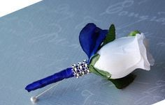 White Rose Boutonniere with Royal Blue Ribbon Angel Isabella http://www.amazon.com/dp/B00IKU8TN2/ref=cm_sw_r_pi_dp_alCuub0A6744J