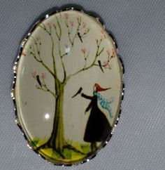 """Collectible Button Lady Under Tree Blackbirds  1"""" x 3/4"""" Oval Button Metal Glass"""