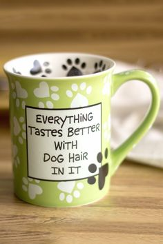 Dog lovers everywhere share a hairy secret . . . doggy fur gets into everything. Fortunately our comical mug has the answer: don't despair embrace the hair! Designed by New York potter Lorrie Veasey.
