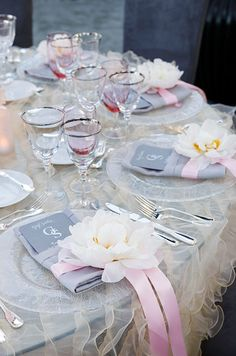 Fully bloomed peonies punctuate each guest's place setting, adding huge amounts of texture and glamour.
