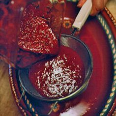 Red Chile Sauce (20 dried New Mexico red chiles 2 cloves garlic, peeled and crushed 1 small yellow onion, peeled and quartered 1 tsp. ground cumin Salt 1 tsp. sugar)