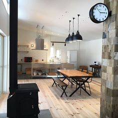 Some parts I like, like the use of commercial counters in the kitchen. Diy Interior, Interior Styling, Interior Architecture, Interior Decorating, Interior Design, Kitchen Chairs, Home Decor Kitchen, Kitchen Interior, Farmhouse Kitchen Island