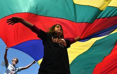 A young athlete plays under a parachute during the Special Olympics Track & Field Event in Cicero.