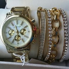 HP! Adrienne Vittadini Gold Watch & 4 Bracelets St Brand new with tags,  box and guaranty, MSRP $125.00  5pc Set includes:  Gold metal watch with mother of pearl and simulated diamonds  4 bracelets as pictured   I ship same day of purchase if paid before 4pm central time. Adrienne Vittadini Accessories Watches