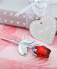 Red Crystal Rose Favor  Show your guests that love is in bloom with this crystal red rose favor.    Adored throughout time, roses of all colors are known for their beauty and strength. But the red rose stands alone as the true symbol of true love!