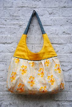 I have this fabric...great idea for a bag!