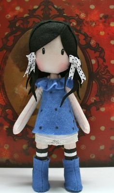 Another great felt doll. Love the contrast of the dark black hair and the bright blue dress.