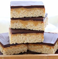 Copycat Whatchamacallit Bars-All you need is a handful of ingredients and 20 minutes of your time to make these chewy peanut butter bars topped with a layer of caramel and chocolate ganache. A delicious homemade version of the Whatchamacallit® candy bar! This dessert recipe will please chocolate lovers of any age, any time of the year.