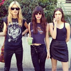 Three grunge girls. I'm sure these chicks are really nice, but I'll never know because they're too cool to approach