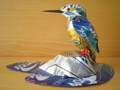 Colorful hummingbird sculpture made from beer cans by Japanese artist, Macaon 鳥, incorporating the color and pattern from the cans.