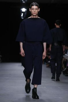 """Designer Juun.J titled his spring/summer 2014 menswear show """"UNUNIFORM"""". The concept of the collection, according to the show notes, was for the house to disintegrate """"the barrier of the 'familiar'..."""