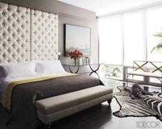 Cristina Azario master bedroom: tufted headboard, Australian Labradoodle, charcoal, white, beautiful light.  Photographer: Bjorn Wallander. Via Elle Decor.