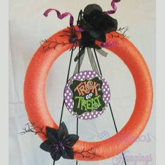 Trick or Treat!  #Halloween #Halloweenwreath  #trickortreat #yarn #yarnwreath #trickortreatwreath #orange #orangeandblack #spiders #wreaths #Fayetteville #handmade #hopeshangings #fayettevillenc #fortbragg #fortbraggnc #orangewreath
