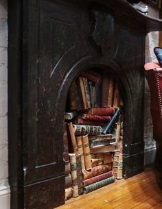 neat idea for a fake fireplace ... all those books I have