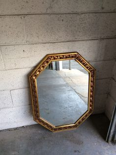 "Gold octagon mirror. 33"" height. 24"" wide"