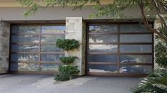 With bronzed garage door panel frames, these glass doors stand out as a contempo. - Contemporary and modern garage door ideas - Door Design Martin Garage Doors, Garage Door Cost, Cheap Garage Doors, Garage Doors Prices, Garage Door Panels, Glass Garage Door, Garage Exterior, Garage Door Makeover, Garage Door Design