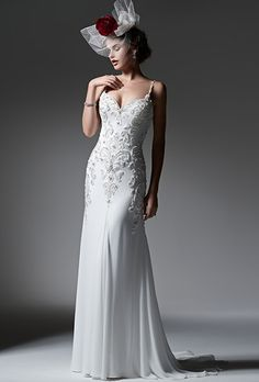 Sottero & Midgley. See more details from Sottero & Midgley��Elegant Paris chiffon creates this streamlined sheath wedding dress, accented with sparkling Swarovski crystals and opalescent pearls. Finished with sexy beaded spaghetti straps, romantic sweetheart neckline and crystal buttons over zipper closure.