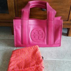 "Tory Burch Mini Tory tote Magenta (dark pink) NWOT Never used....received as gift but a bit too big for my taste (been sitting in my closet) 100% leather with canvas accent Comes with dustbag (wrong dustbag pictured) 100% authentic  13w x 8h x 6d with 7"" drop  ❌NO LOWBALL OFFERS  ❌ NO NEGOTIATING OVER COMMENT,  USE OFFER BUTTON ❌ NO TRADES Tory Burch Bags Satchels"
