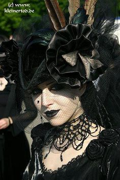 Lovely and complicated Victorian Mourning outfit by German model. Nice neck piece and heasgear as well