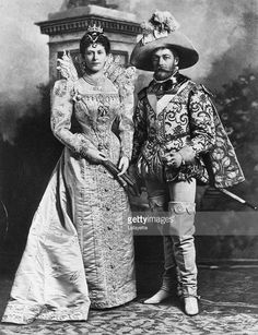 The Duke (1865 - 1936) and Duchess of York (1867 - 1953), later King George V and Queen Mary in costume as the 3rd Earl of Cumberland and a lady at the court of Marguerite de Valois for a fancy dress ball held in Devonshire House.