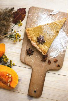 Pumpkin pie on the wood desk by livefolk on Creative Market