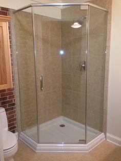 Glass corner shower to make small bathroom feel bigger