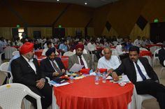 Dignitaries on the round table going through the programme schedule